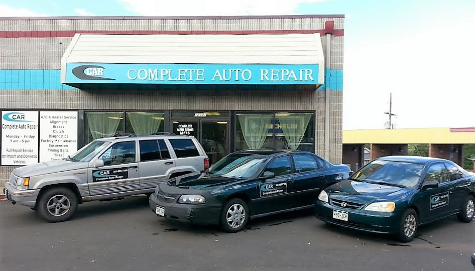 Complete Auto Repair cars parked in front of fleet service building